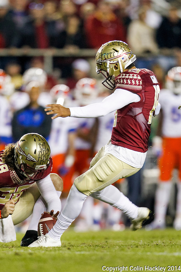 TALLAHASSEE, FL 11/29/14 FSU-UF112914-Florida State's Roberto Aguayo kicks the final field goal against the University of Florida's during second half action Saturday at Doak Campbell Stadium in Tallahassee. The Seminoles beat the Gators 24-19.<br /> COLIN HACKLEY PHOTO