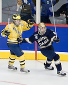 Chad Langlais (Michigan - 7), Ryan Thang (Notre Dame - 9) - The University of Notre Dame Fighting Irish defeated the University of Michigan Wolverines 5-4 in overtime in their 2008 Frozen Four Semi-Final matchup on Thursday, April 10, 2008, at the Pepsi Center in Denver.