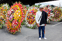 A man wainting on front of silletas before to start  the 58th Silleteros' parade in the framework of the flowers' fair, this year the silleteros parade was declared intangible heritage of Colombia. Medellín, Colombia 09/08/2015