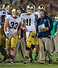 Sept. 14, 2013; Brian Kelly talks with quarterback Tommy Rees (11) and running back Cam McDaniel (33).<br /> <br /> Photo by Matt Cashore