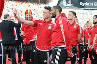 Some of the Wales players take selfies during the homecoming celebrations at the Cardiff City stadium on Friday 8th July 2016 for the Euro 2016 Wales International football squad.<br /> <br /> <br /> Jeff Thomas Photography -  www.jaypics.photoshelter.com - <br /> e-mail swansea1001@hotmail.co.uk -<br /> Mob: 07837 386244 -