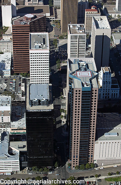 aerial view above skyscrapers in San Diego including Merrill Lynch First Bank Copley symphony hall and heliport