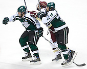Kyle Kucharski (Boston College - Saugus, MA) is sandwiched by Daniel Vukovic (Michigan State - North York, ON) and Zak McClellan (Michigan State - Frankenmuth, MI). The Michigan State Spartans defeated the Boston College Eagles 3-1 (EN) to win the national championship in the final game of the 2007 Frozen Four at the Scottrade Center in St. Louis, Missouri on Saturday, April 7, 2007.