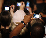 People take photos as former US president Bill Clinton speaks to a crowd of Hillary Clinton supporters that had assembled to watch the televised CNN debate between Democratic presidential candidates Hillary Clinton and Barack Obama, Feb. 21, 2008, at Sunset Station, San Antonio, Texas. (Darren Abate/PressPhotoIntl.com)