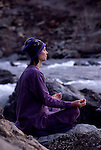 Woman meditating by the American River