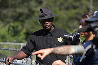 Edgefield County, SC Sheriff Adell Dobey observes a raid on a puppy mill in Johnston, SC on Tuesday, Sept. 11, 2012. HSUS workers found over 200 dogs, nine horses and 30-40 fowl.