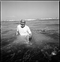 former Shirat Ayam settlement, Sept 12 2005..Saker Abed, 85, enjoys a sea bath for the first time in many years. Hours after the Israeli left the area, thousands Khan Younes inhabitants rushed to the beach, formerly Shirat Hayam Jewish settlement, less than 3 kilometers from their homes.