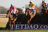King Jack ridden by Richard Johnson (L) leads race winner Only Witness ridden by Brendan Powell during the Cogent Ltd John Bigg Oxo Handicap Chase - Horse Racing at Huntingdon Racecourse, Cambridgeshire - 23/02/12- MANDATORY CREDIT: Gavin Ellis/TGSPHOTO - Self billing applies where appropriate - 0845 094 6026 - contact@tgsphoto.co.uk - NO UNPAID USE.