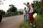 DETERMINATION.With a look of resolve, a schoolgirl hails a truck for a ride home after classes in her school in the Sierra del Rosario mountains west of Havana. It may be the children of the next generation who decide the fate of Cuba and its fate with the United States. Erik Kellar/Naples Daily News