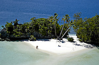 Aerial of three Coconut Island in Palau Micronesia