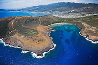 An aerial shot on a clear day of Hanauma Bay facing Hawai'i Kai and the Ko'olau Mountain Range, O'ahu.
