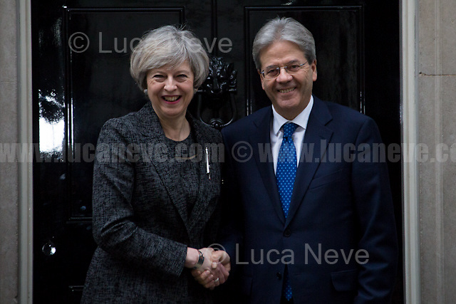 "London, 09/02/2017. Today, The Italian Prime Minister, Paolo Gentiloni, visited 10 Downing Street where he had a meeting with the British Prime Minister Theresa May. Noticeably, the Italian Prime Minister used - again (His predecessor and leader of the PD - Democratic Party - Matteo Renzi started this ""tradition"" to visit 10 Downing Street with a non-Italian car in 2014 replacing the official Maserati Quattroporte - number plate ""Ita 1"" - with a Chrysler 300c made by FCA, Fiat Chrysler Automobiles. FIAT - Aka Fabbrica Italiana Automobili Torino - moved its tax domicile from Italy to the UK just the day before - see my story here https://goo.gl/hH5a6O) - a different car for his official visit in the UK. In fact, this time the official Maserati Quattroporte ""Ita 1"", was replaced by an Audi A8L 6.3 W12 quattro, a luxury car produced by the German and world leader of the car industry, Volkswagen Group."