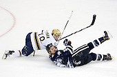 T.J. Tynan (Notre Dame - 18), Mike Beck (UNH - 25) - The University of Notre Dame Fighting Irish defeated the University of New Hampshire Wildcats 2-1 in the NCAA Northeast Regional Final on Sunday, March 27, 2011, at Verizon Wireless Arena in Manchester, New Hampshire.
