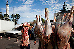 A butcher delivers meat in front of a Salfist mosque in Tunis, the site of recent riots against a TV channel that ran a movie Salfists found offensive. Salafists are finding a voice for thier views after years of persecution.