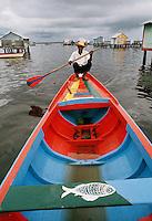 Dweller of stilt houses in Lake Maracaibo in Venezuela using his fishing boat for transportation..