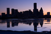 Stock photo of the silhouette of the skyline reflected on a rooftop after a storm