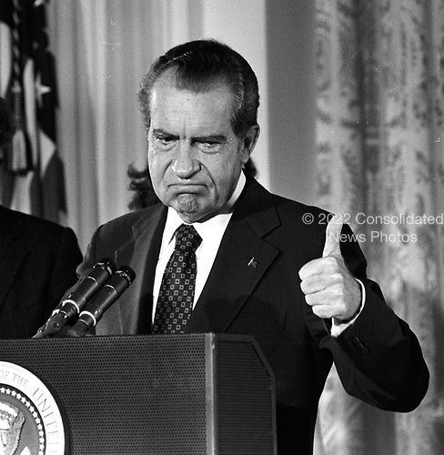 File photo taken on 9 August, 1974 of United States President Richard M. Nixon as he consoles his staff in the East Room of the White House after he resigned the Presidency the night before..Credit: Arnie Sachs / CNP