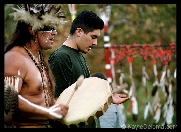 Chumash elder in regalia and his son sing Chumash songs at a Gabrielino/Tongva clan gathering at the Peter Strauss Ranch in the Santa Monica Mountains, CA,