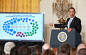 United States President Barack Obama gestures towards a chart as he makes remarks in the East Room of the White House in Washington, D.C. calling on Congress to return powers that would allow him to reform Executive Branch agencies of the U.S. Government on Friday, January 13, 2012..Credit: Ron Sachs / CNP