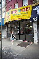 """A branch of the Silver Crust restaurant is seen in Crown Heights in Brooklyn in New York on Saturday, August 30, 2014. The Jamaican fast food eatery is being sued by its older rival, Golden Krust, for using their name, specifically, the misspelling of """"Krust"""" which can cause confusion in consumers between the two chains. (© Richard B. Levine)"""