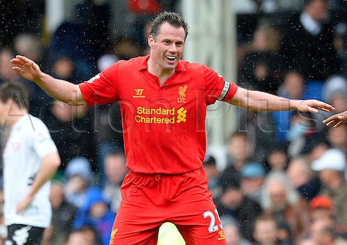 12.05.2013 London, England.  Jamie Carragher of Liverpool celebrates like Daniel Sturridge after Sturridge scores during the Premier League game between Fulham and Liverpool from Craven Cottage...