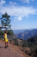 Young woman looking into the Copper Canyon or Barranca del Cobre, Chuhuahua, Mexico