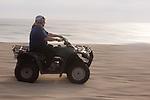 Man riding a Quad on the playa near Migrino, Baja California, Mexico