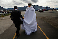 Wedding on the Mendenhall Glacier in  the Tongass National Forest.  A couple who met on the internet decided to be married in an unusual way, riding by helicopter onto the glacier.  Many are tourists--Anna Hall and John Bohach from California were married on the first sunny day in Juneau in three weeks.
