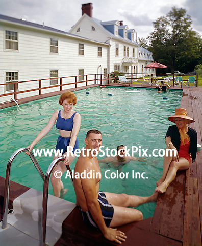 People sitting by pool