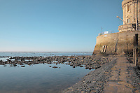 The base of the Phare de Cordouan, or Cordouan Lighthouse, with low tide entrance open, built 1584-1611 in Renaissance style by Louis de Foix, 1530-1604, French architect, located 7km at sea, near the mouth of the Gironde estuary, Aquitaine, France. This is the oldest lighthouse in France. There are 4 storeys, with keeper apartments and an entrance hall, King's apartments, chapel, secondary lantern and the lantern at the top at 68m. Parabolic lamps and lenses were added in the 18th and 19th centuries. The lighthouse is listed as a historic monument. Picture by Manuel Cohen