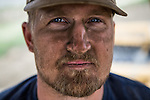 DUNNIGAN, CA - APRIL 4, 2015:  Farmer Garrett Schaad's face is covered with dust from plowing a dry rice field. CREDIT: Max Whittaker for The New York Times