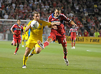 Chicago defender Austin Berry (22) clears a long ball into Columbus midfielder Chris Birchall (8).  The Chicago Fire defeated the Columbus Crew 2-1 at Toyota Park in Bridgeview, IL on June 23, 2012.