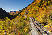 Crawford Notch State Park - Autumn foliage along the old Maine Central Railroad in Hart's Location, New Hampshire USA. Chartered in 1867 as the Portland & Ogdensburg Railroad Company then leased to the Maine Central Railroad in 1888 and later abandoned in 1983. Since 1995 the Conway Scenic Railroad, which provides passenger excursion trains has been using the track.