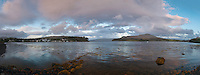Panorama of Loch Portree in the Isle of Skye. The town on Portree can be seen on the left. This side of the lake shore is full of BnB's ready to accomodate the tourists visiting the island.