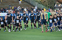 San Jose Earthquakes and Philadelphia Union walk onto the pitch. The San Jose Earthquakes defeated the Philadelphia Unioin 1-0 at Buck Shaw Stadium in Santa Clara, California on September 15th, 2010.