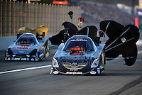 Nov 13, 2010; Pomona, CA, USA; NHRA funny car driver Cruz Pedregon (right) against Ashley Force Hood during qualifying for the Auto Club Finals at Auto Club Raceway at Pomona. Mandatory Credit: Mark J. Rebilas-