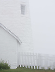 Another* white-on-white shot of the lighthouse in the fog.