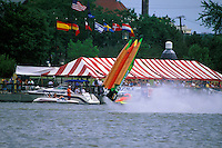 Frame 6: Halfway around the first lap, Wyatt Nelson (#39) blows the boat over crashing back to the water. Nelson was unhurt in the crash. (SST-120 class) Bay City, MI 1998