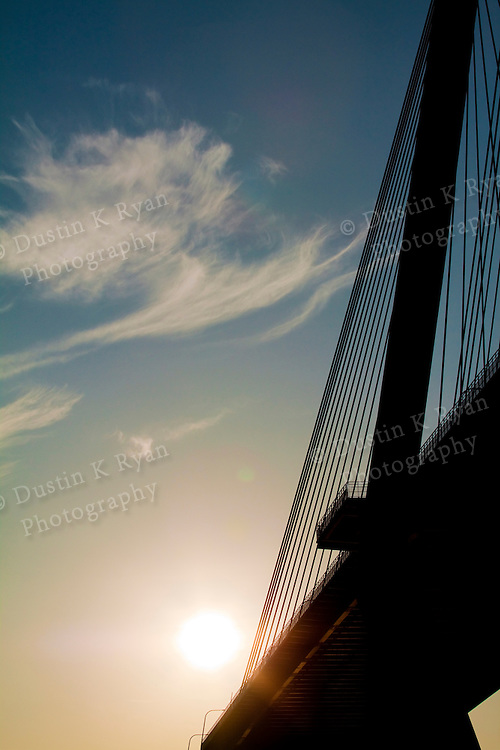 arthur ravenel jr bridge over the cooper river with wispy clouds and blue sky in Charleston South Carolina