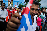 A Cuban man waves the national flags during the annual celebration of the Cuban Revolution anniversary in Santiago de Cuba, Cuba, 26 July 2008. The Cuban revolution began when the poorly armed Cuban rebels, led by Fidel Castro, attacked the Moncada Barracks in Santiago de Cuba on 26 July 1953. The attack was easily defeated and most of the rebels were captured and later executed by the Batista regime. Although Fidel Castro had been sentenced to 15 years of prison, after less than two years he was released, he went to Mexico and in 1956, back in Cuba again, his guerilla group started a new rebellion.