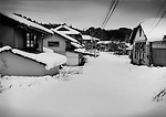 Nuclear winter in Fukushima: Peaceful winter scene in the extended evacuation zone where not a soul has passed since the snow fell.  Tsushima residents were forced to evacuate their village after a wind-driven radioactive cloud from an explosion at Fukushima Dai Ichi nuclear power plant scored a direct hit on this valley.  Estimated annual radiation levels exceed 50 millisieverts, making the village unihabitable for years, maybe even decades as Tsushima is one of most irradiated villages in Fukushima Prefecture.