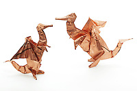 New York, NY, USA - November 2, 2011: Two Origami dragons folded out of copper sheet by Esme Cribb