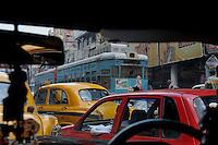 A tram on a crowded road in Kolkata.West Bengal, India 2009 Arindam Mukherjee