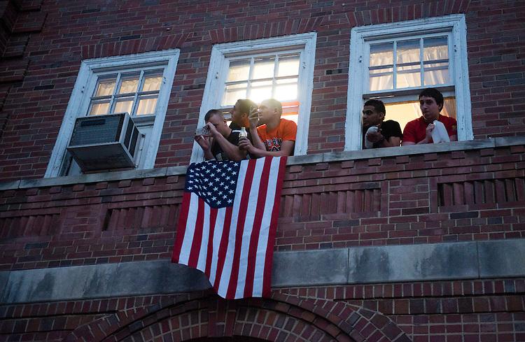Ohio University students watch the Presidential motorcade from their dorm room at Ohio University.  Photo by Ben Siegel/ Ohio University