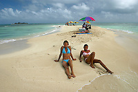 Two Venezuelan girls sunbathe on the beach. These small islands near the coastal town of Chichiriviche are popular with domestic tourists.