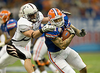 01 January 2010:  Aaron Hernandez of Florida runs the ball away from Cincinnati defender after Hernandez catches a pass from Tim Tebow during the game during Sugar Bowl at the SuperDome in New Orleans, Louisiana.  Florida defeated Cincinnati, 51-24.