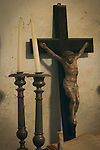 Crucifix and candle holders in museum, Mission San Juan Baptista, Calif.