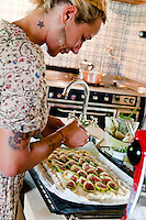 Chef Maddalena Caruso preparing a fig, ricotta cheese, almond and honey tart in her kitchen