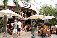 Tourists looking at the menu outside Yaxche Mayan restaurant in Playa del Carmen, Riviera Maya, Quintana Roo, Mexico.