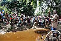 The residents of the remote village of Pania gather on the banks of the Sankuru River to see off the canoes carrying an ophthalmology expedition headed by Dr Richard Hardi. <br /> <br /> From his base in Mbuji Mayi Hungarian ophthalmologist Friar Richard Hardi and his team travelled deep into the Congolese rainforest, by 4x4 and canoe, to treat people in isolated communities most of whom have never seen an ophthalmologist. At a small village called Pania they established a temporary field hospital and over the next three days made hundreds of consultations. Although both conditions are preventable, many of the patients they saw had Glaucoma or River Blindness (onchocerciasis) that had permanently damaged their eyesight. However, patients with cataracts, a clouding of the eye's lens, who were suitable for treatment were booked for an operation. For two days the team carried out the ten minute procedure on one patient after another. The surgery involves making a 2.2mm incision into the remove the damaged lens that is then replaced by an artificial one. Doctor Hardi is one of the few people willing to make such a journey but is inspired to do so by his faith and, as he says: 'Here I feel that I can really make a difference in people's lives'. /Felix Features